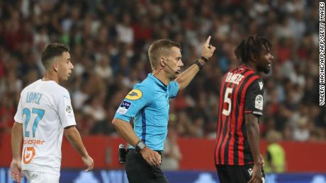 Referee Clement Turpin suspends the game between  Nice and Olympique de Marseille after persistent homophobic chants and the display of a disparaging banner.