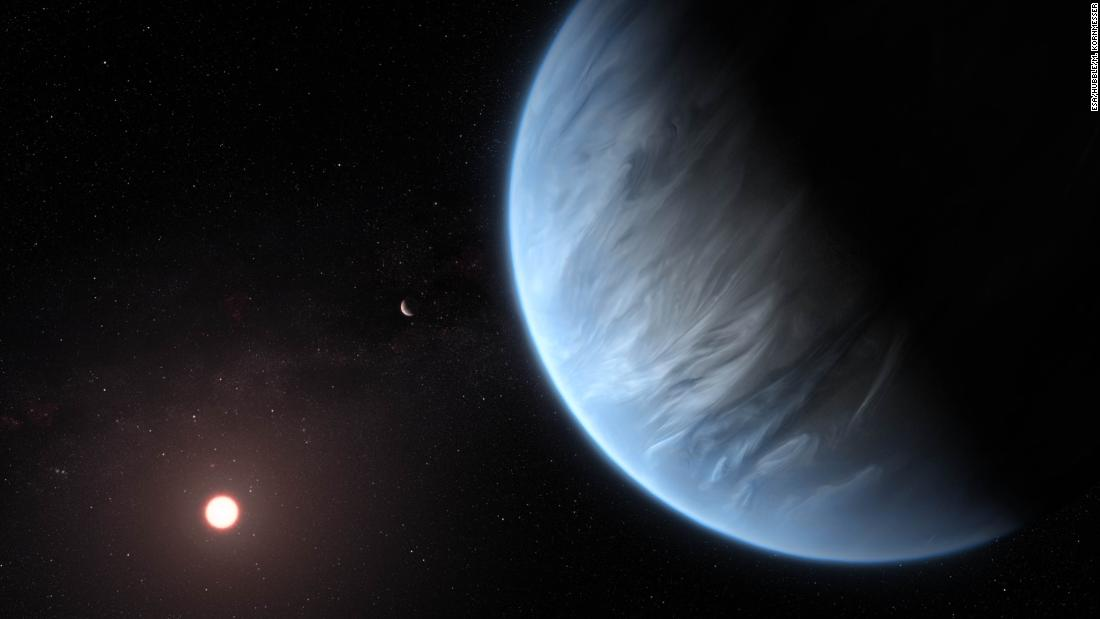 This artist's illustration showcases exoplanet K2-18b orbiting its host star. It's currently the only super-Earth exoplanet that has water vapor in its atmosphere and could be within the right temperature to support life.