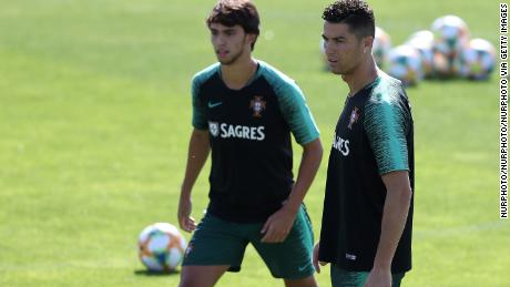 Joao Felix (L) and Portugal's forward Cristiano Ronaldo with the Portugal national team.