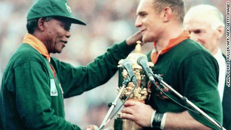 Nelson Mandela hands Francois Pienaar the Webb Ellis Cup after the Springboks beat the New Zealand All Blacks in the 1995 Rugby World Cup