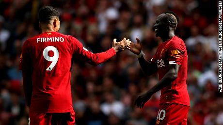 Sadio Mane and Roberto Firmino celebrate Liverpool's second goal.
