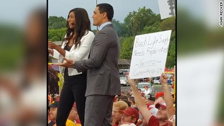 Iowa State fan Carson King holding up a sign asking for beer money at the College Gameday set.