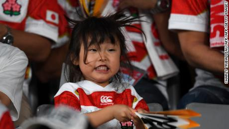 A young Japan fan cheers on the team before the Japan 2019 Rugby World Cup Pool A match between Japan and Russia.