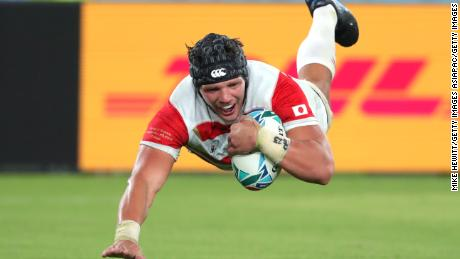 Pieter Labuschagne of Japan scores his team's third try.