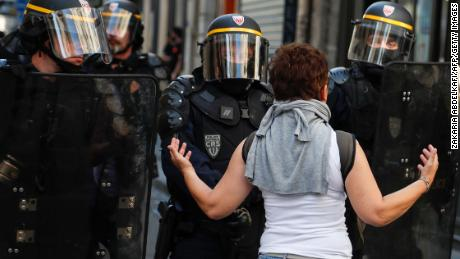 A woman speaks to riot policemen during an anti-government demonstration in Paris in September 2019