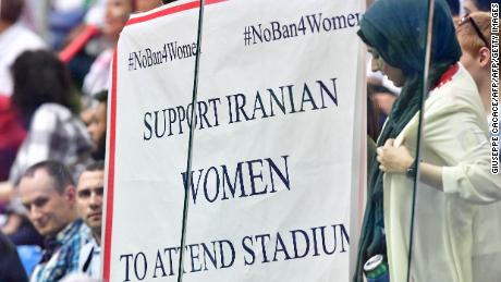 """A banner reading """"Support Iranian women to attends stadiums"""" is displayed during the Russia 2018 World Cup Group B football match between Morocco and Iran."""