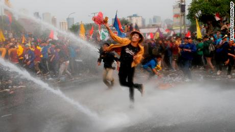 Police tear gases protesting students in Makassar, Indonesia