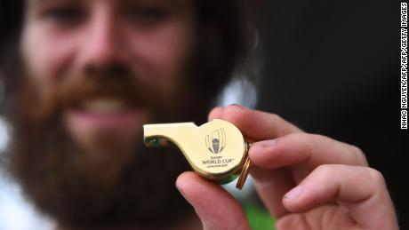 James Owens holding the whistle for the opening match of the Rugby World Cup 2019.