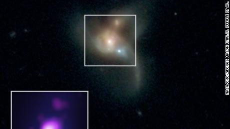 These three black holes are going to crash into each other