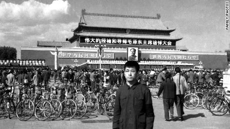 """Xiao gathered with other people on Tiananmen Square for Mao's memorial meeting in 1976. The banner on Tiananmen Square reads """"Memorial meeting for the great leader and mentor Mao Zedong."""""""