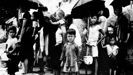 Chinese refugees queuing for a meal in Hong Kong in May 1962, after fleeing mass famine on the mainland.