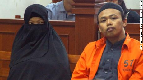 Dian Yulia Novita with her husband Nur Solikin during their trial at East Jakarta District Court in Jakarta, on August 23, 2017. The ex-nanny was sentenced to seven-and-a-half years jail for her involvement in an Islamic State-inspired plot to carry out a suicide bomb attack on the presidential palace in Jakarta.