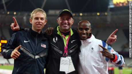 Salazar (center) celebrates gold and silver medals for Mo Farah (right) and Galen Rupp (left) at the 2012 Olympics.