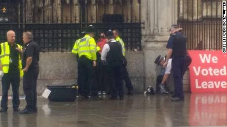 Man detained after pouring 'petrol' over himself near Houses of Parliament