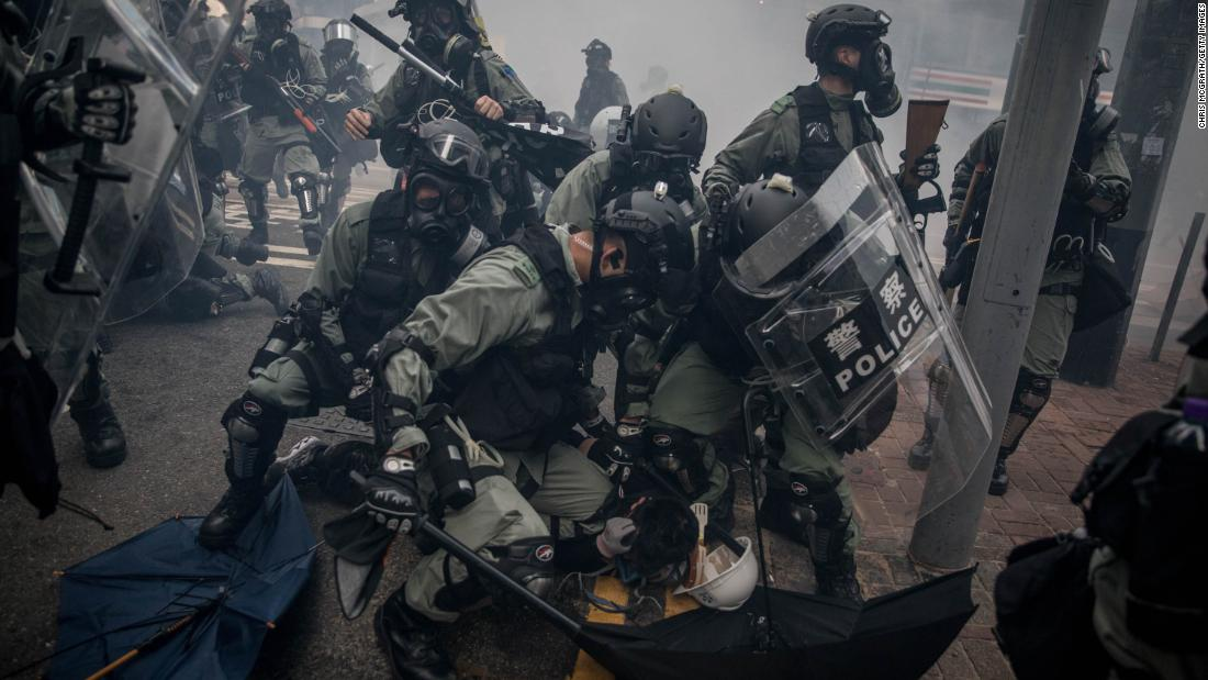 Police tackle and arrest pro-democracy protesters during clashes on October 1.