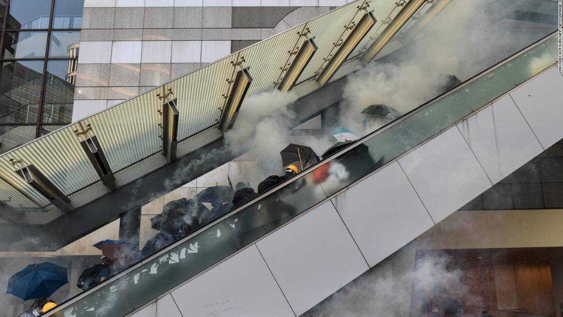 Protesters react after police fired tear gas near the central government offices in Hong Kong's Admiralty area on October 1.