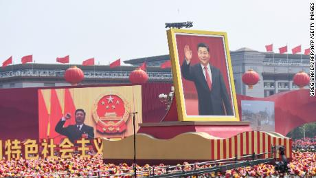A float with a giant portrait of Chinese President Xi Jinping passes by Tiananmen Square during the National Day parade in Beijing on October 1.