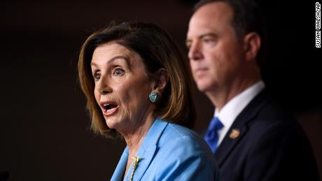 House Speaker Nancy Pelosi, joined by House Intelligence Committee Chairman Rep. Adam Schiff, speaks during a news conference on Capitol Hill in Washington, October 2.