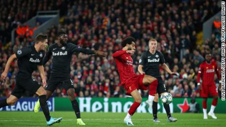Mohamed Salah scores his side's fourth to secure victory.