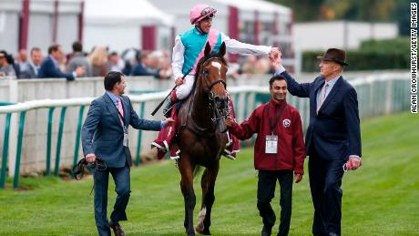 Imran Shawani (second from right) has worked for trainer John Gosden (right) for 14 years.