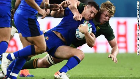 Italy's Luca Morisi is tackled by Pieter-Steph du Toit in the Pool B encounter.