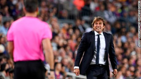 Inter Milan coach Antonio Conte protests to an officialduring the 2-1 defeat at Barcelona.