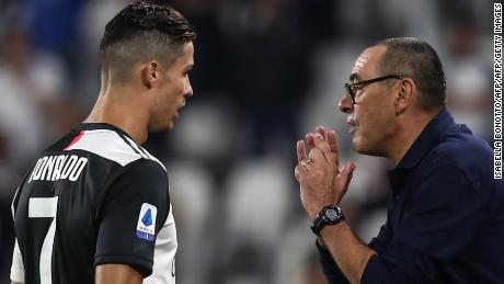 Juventus' Italian coach Maurizio Sarri (R) gives instructions to Juventus' Portuguese forward Cristiano Ronaldo during the  match Juventus vs Verona on September 21.