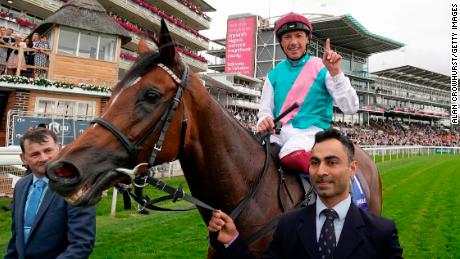 Imran Shawani holds Enable as Frankie Dettori celebrates after winning the Yorkshire Oaks in August.