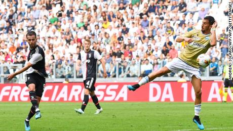 Juventus midfielder Miralem Pjanic (L) shoots to open the scoring during the Serie A clash with Spal.