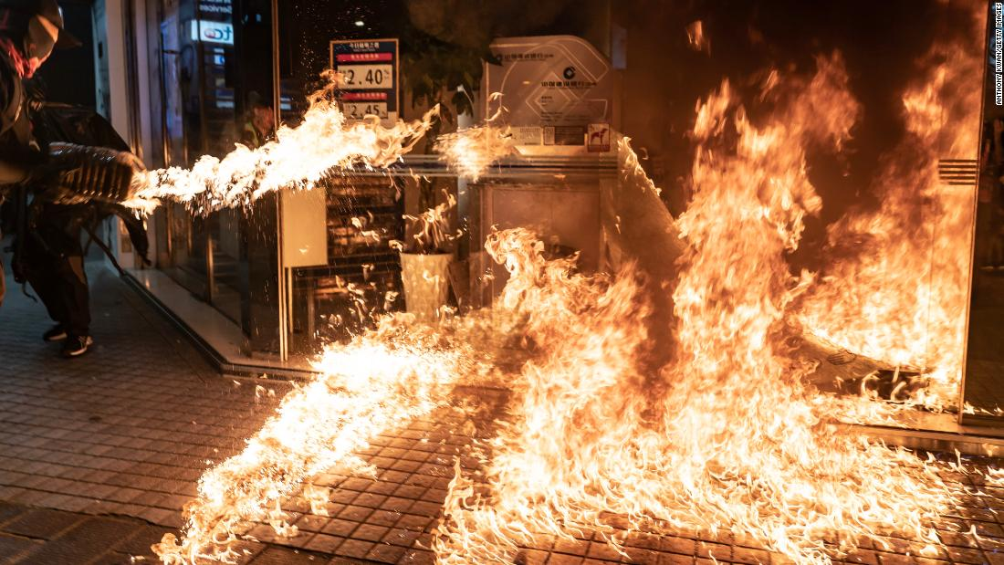 Protesters set a fire at a China Construction Bank.