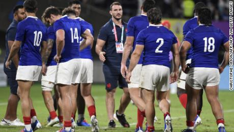 France's players trudge off after holding off the strong challenge of Tonga to win the Rugby World Cup Pool C in Kumamoto 23-21.