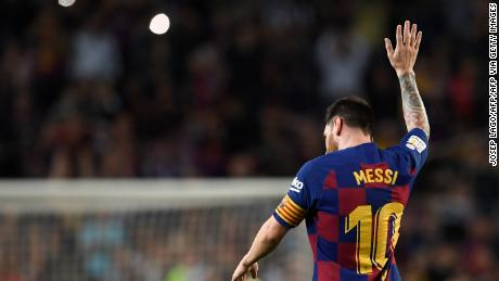 Lionel Messi soaks up the adulation of the crowd after a trademark free-kick.