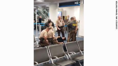 Passenger bypasses gate agent, runs onto plane at Miami International Airport