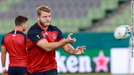 Joe Launchbury passes the ball during the England training session in Kobe, Japan.