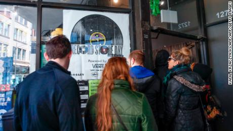 Customers wait in line to enter Chicago's Shuga Records on Record Store Day on April 13, 2019.