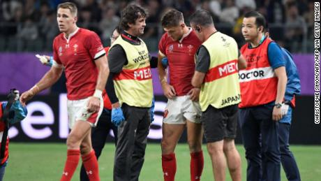 Dan Biggar is attended to by medics after a collision with Liam Williams.
