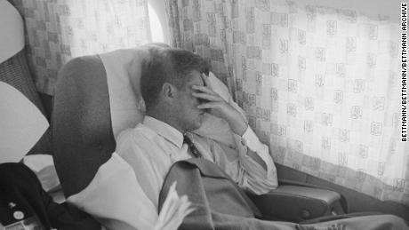While in the midst of a vigorous campaign, John F. Kennedy takes a few minutes to rest his eyes and catch a snooze while en route from St. Louis to New York City.