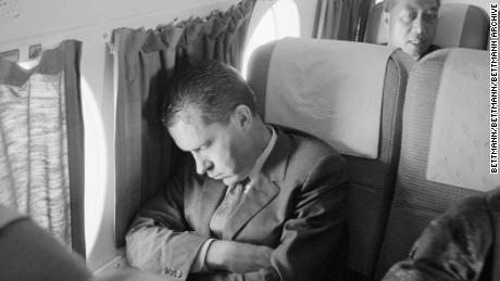 Vice President Richard M. Nixon taking a nap aboard an interisland plane from Kauai to Hilo, Hawaii, during his two-day presidential campaign here.