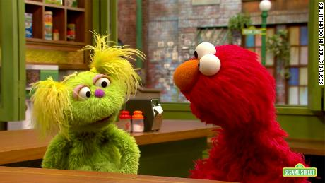 Karli, left, talks to her friend Elmo about her mom going to meetings to help her recover from addiction.