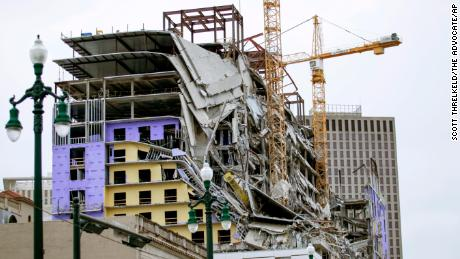 Crews are scrambling to find 2 missing workers in the Hard Rock Hotel wreckage before another collapse