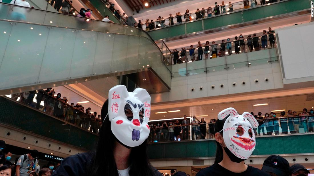 "Protesters wearing masks in defiance of <a href =""https://www.cnn.com/2019/10/04/asia/hong-kong-face-mask-ban-meeting-intl-hnk/index.html"" target =""_blank&ampquott;>a recently imposed ban</un> gather at a shopping mall on October 13."