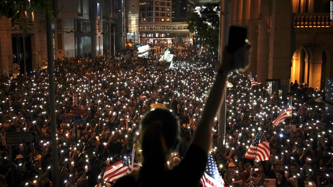 Protesters use the lights on their phones during a rally in central Hong Kong's business district.
