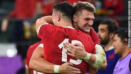 Wales fly-half Dan Biggar hugs Owen Watkin at full-time.