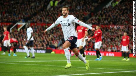 Adam Lallana celebrates scoring Liverpool's equalizer at Old Trafford.