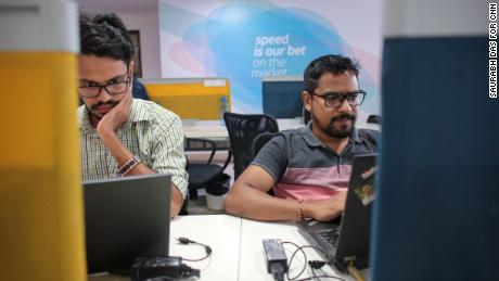 """Employees at Paytm's headquarters, which is decorated with phrases like """"Go big or go home"""" and """"speed is our bet."""" (Saurabh Das for CNN)"""
