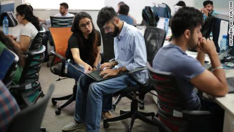 Employees work at Patym's headquarters. (Saurabh Das for CNN)