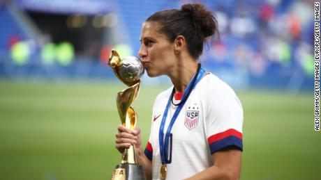Lloyd kisses the FIFA Women's World Cup Trophy.