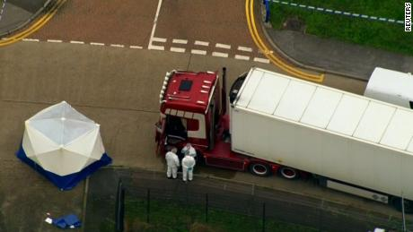 UK police free 3 suspects on bail in truck deaths case