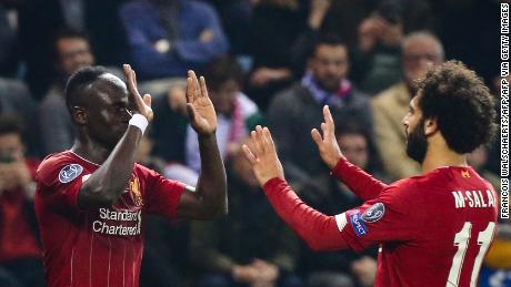 Liverpool's Sadio Mane (L) celebrates with teammate Mohamed Salah (R) after scoring.
