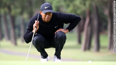 Woods lines up a putt on the 11th green.